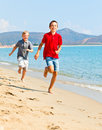 Boys on a beach two happy kids running along Royalty Free Stock Images