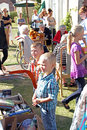 Boys at boot fair fete photo of two young buying from a stall a in faversham kent on th sept photo ideal for outdoor activities Royalty Free Stock Photo