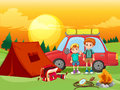 Boys camping out in the field Royalty Free Stock Photo
