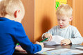 Boys children kids writing on paper at home happy childhood two blond brothers with pen piece of doing homework Royalty Free Stock Image