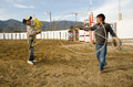 Boys doing rope tricks in arena two mexican twirling before a rodeo Stock Image