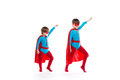 Super heroes in red mask and cloak running