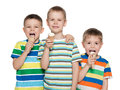 Boys are eating ice cream three fashion standing together and Stock Photography