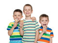 Boys eating ice cream three little are standing together and Stock Images