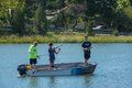 Boys Fishing from a Boat Royalty Free Stock Photo