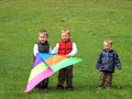 Boys flying kite Stock Image