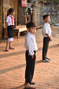 Boys and girl waiting to go to school Royalty Free Stock Photo