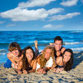 Boys and girls group having fun on the beach teen happy blue sand Stock Photo