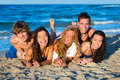 Boys and girls group having fun on the beach teen happy blue sand Royalty Free Stock Images