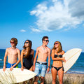 Boys and girls teen surfers happy smiling on beach over dune in summer Royalty Free Stock Photo