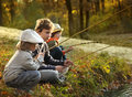 boys go fishing on the river Royalty Free Stock Photo