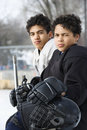 Boys in hockey uniforms.