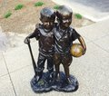 Boys Holding Basketball Statue Royalty Free Stock Photo