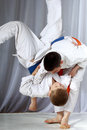 Boys in judogi are training throwing Royalty Free Stock Photo