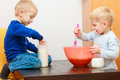 Boys kids baking cake. Children beating dough with wire whisk. Stock Photography
