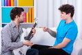 Boys learning to play the guitar at home Stock Photography