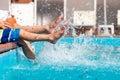 Boys legs splashing water in pool Royalty Free Stock Photo
