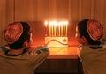 Boys Look at Hanukkah Menorah Stock Image