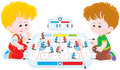 Boys play table hockey kids playing on the floor Stock Photo