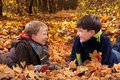 Boys playing in Autumn leaves Stock Photo