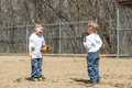 Boys playing baseball two young standing on the field catch Royalty Free Stock Photos