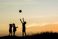 Boys playing football at sunset. silhouette concept Royalty Free Stock Photo