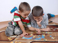 Boys playing the puzzle Stock Photos