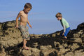 Boys playing on rocks at the seaside two young brothers exploring their holidays near killybegs in west of ireland a very hot Stock Photography