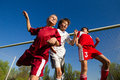 Boys playing soccer little on the sports field next to goal Stock Photography