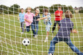 Boys playing soccer in park Royalty Free Stock Photo