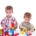 Boys playing with wooden cubes little colourful on the table Stock Images