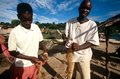 Boys preparing a fishing net, Uganda Stock Photography