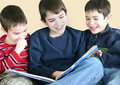 Boys Reading Together Stock Photography