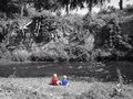 Boys by the river watching water Stock Images
