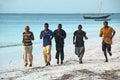 Boys running on the beach sandy of zanzibar island in tanzania africa Stock Images