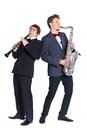 Boys with saxophone and clarinet Royalty Free Stock Photo
