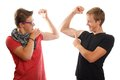 Boys showing off muscles Royalty Free Stock Photo