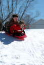 Boys sledding Royalty Free Stock Photo
