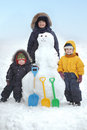 Boys with snow man focus on front Royalty Free Stock Photography