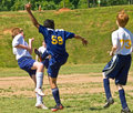 Boys Soccer Kicking the Ball Royalty Free Stock Image