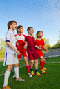 Boys stay next to goal group of little Royalty Free Stock Images