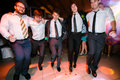 Boys in suits dance on the disco Royalty Free Stock Photo