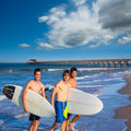 Boys surfers group coming out from beach newport california Royalty Free Stock Image