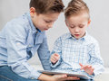 Boys with tablet pc Royalty Free Stock Image