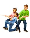 Boys team of three years old kids pulling the rope standing isolated on white Stock Photos