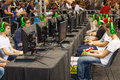 Boys tournament players and gaming consoles row of young playing with a console wearing headphones during romics in rome italy Stock Photos