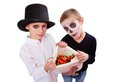 Boys with treats photo of two eerie sack of halloween looking at camera Stock Photo