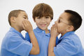 Boys Whispering Royalty Free Stock Photography