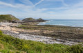 Bracelet Bay the Gower Peninsula South Wales with Mumbles lighthouse Royalty Free Stock Photo
