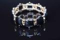 Bracelet with black stones over black Royalty Free Stock Photo